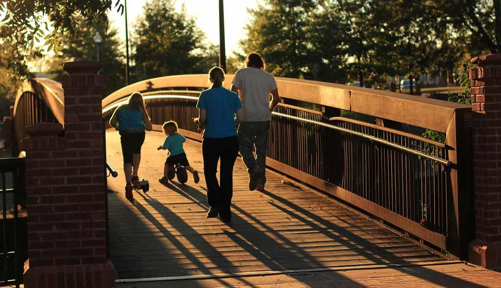 parent-and-childrens-walking-at-evening