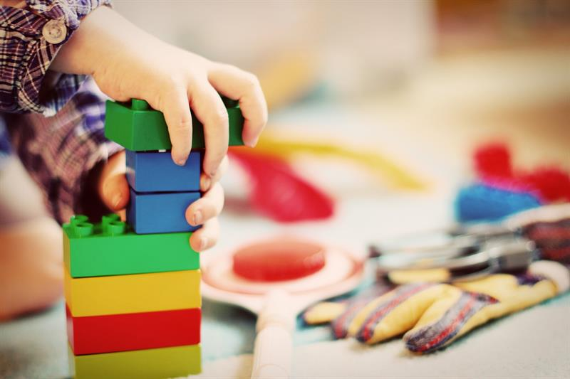 child playing with blocks in preschool